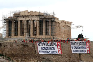 Greek Communists (KKE) display protest banners on Acropolis Hill