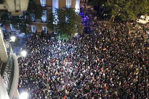 PEOPLE GATHER TO PROTEST AT THE LOWER HOUSE OF THE SPANISH PARLIAMENT
